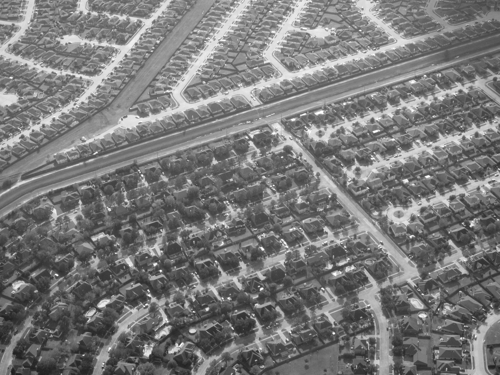 black and white aerial view of suburban homes