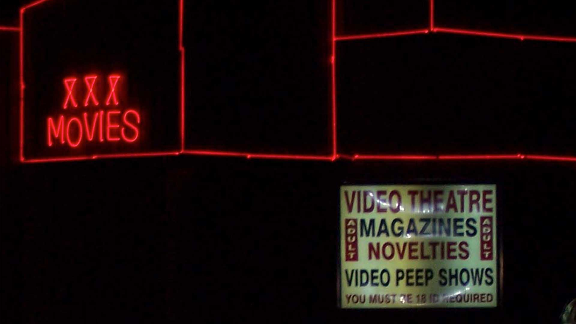 adult store exterior with neon signs