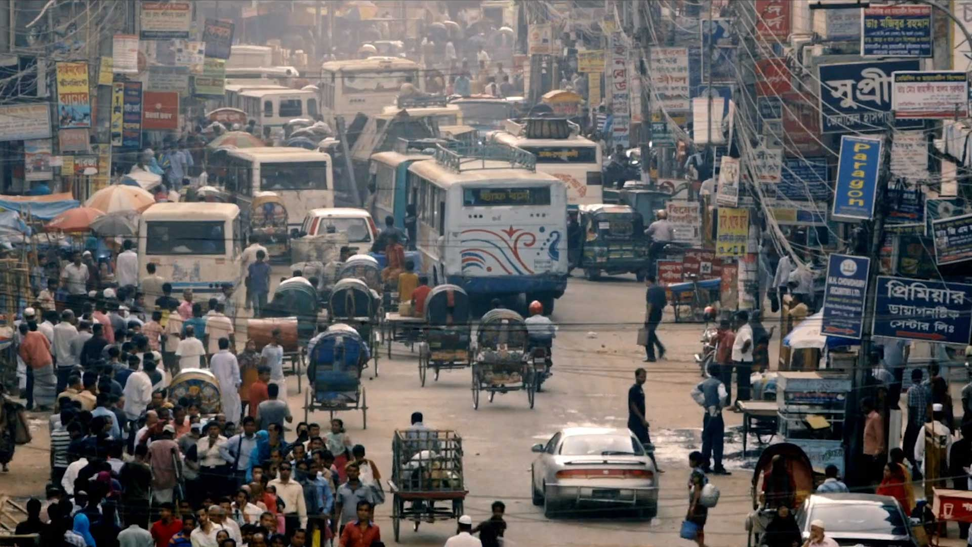 busy street with cars and pedestrians in India