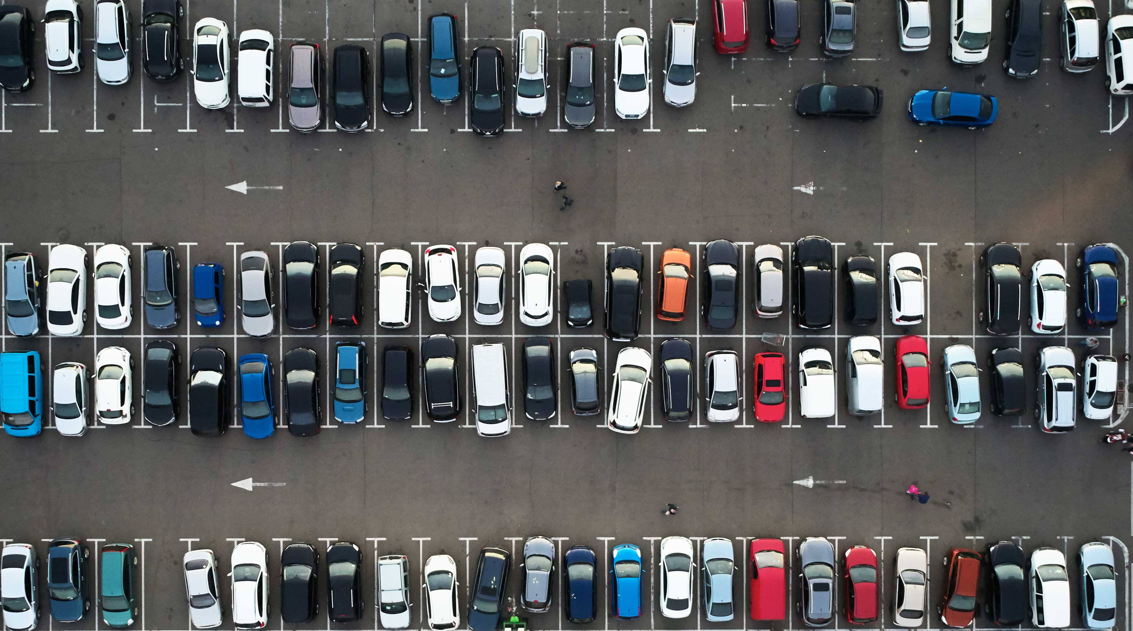 aerial photo of large parking lot of cars