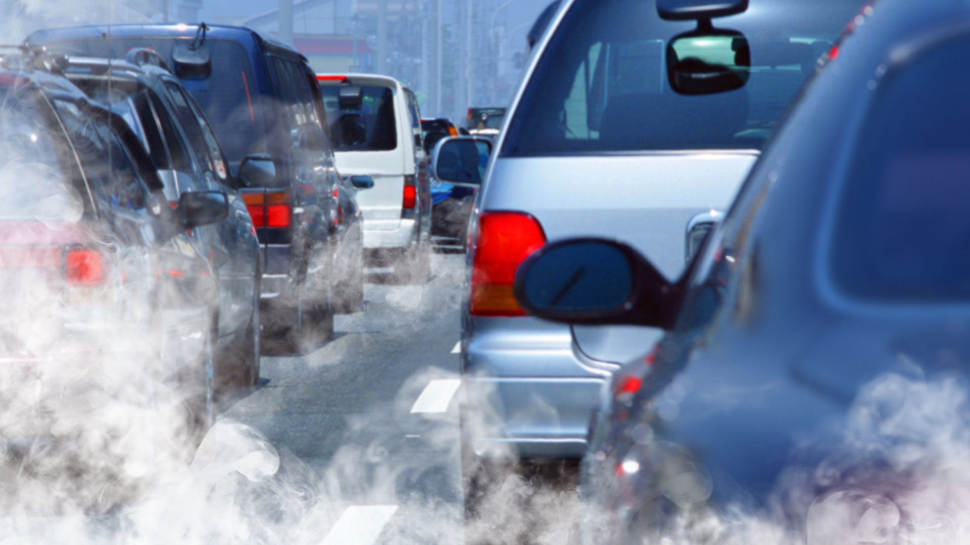 cars in traffic emitting pollution