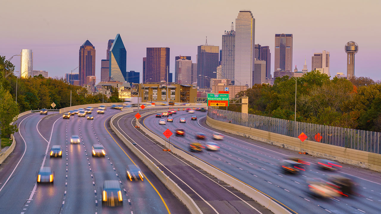 freeway with Dallas skyline in background