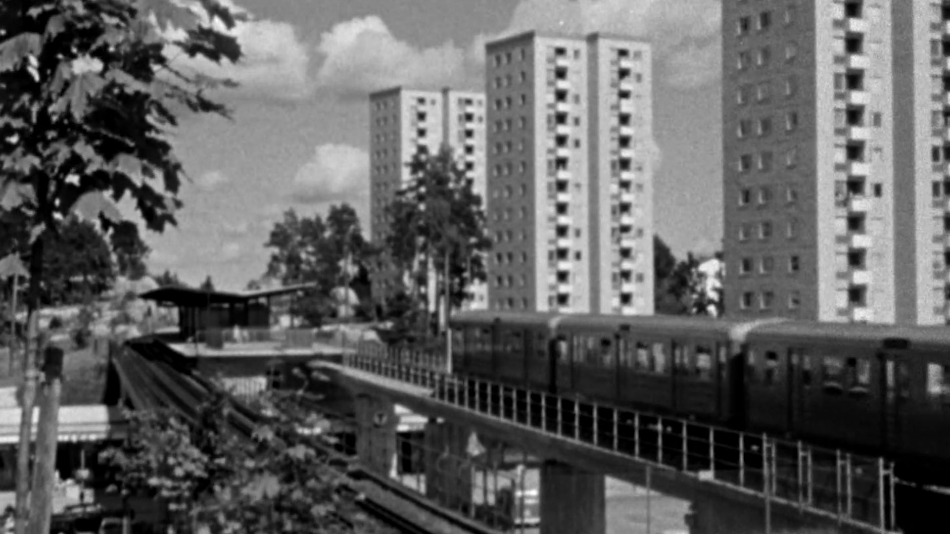 European city with train and buildings in black and white