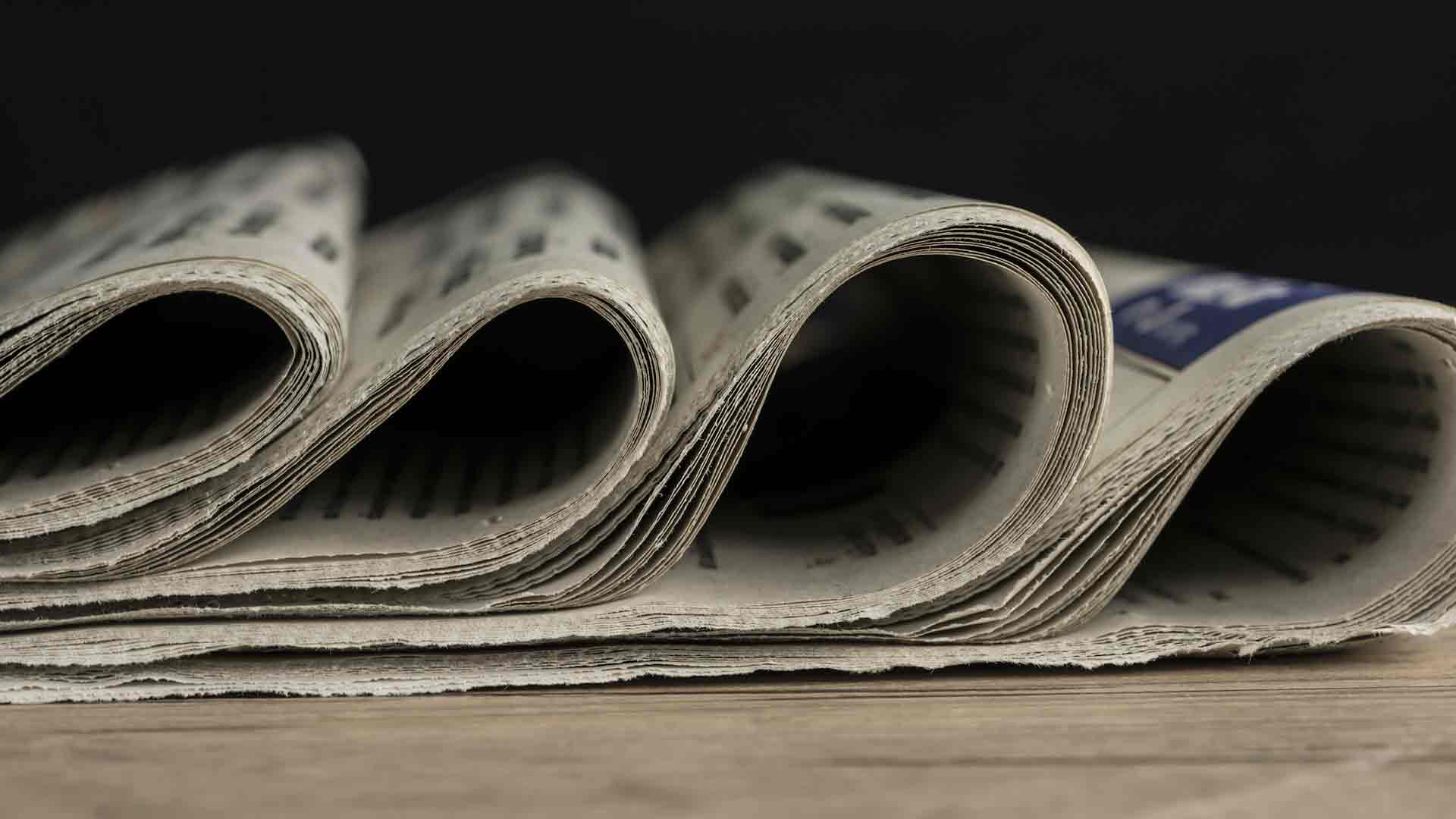 closeup of newspapers for writing press release course