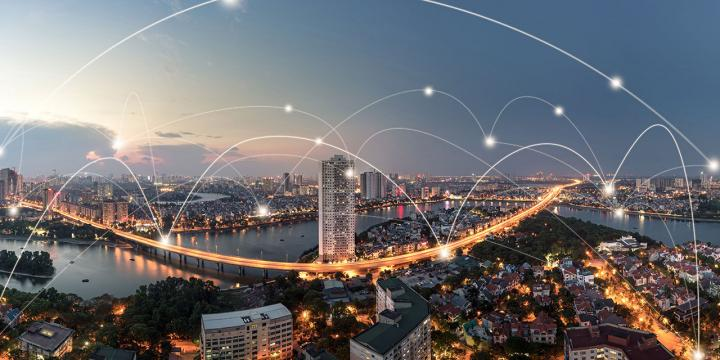 digital network connections over city skyline